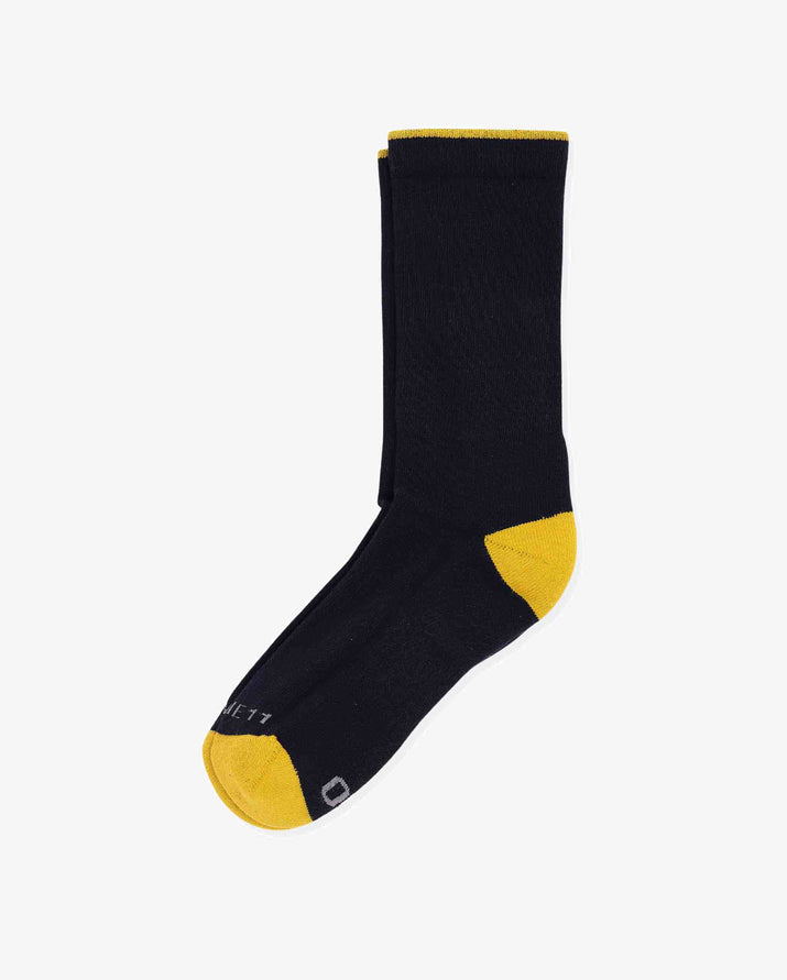 Mens crew sock in navy with yellow caps, laid flat.