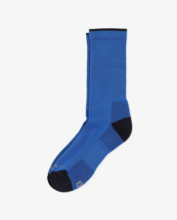 Mens crew sock in royal blue with black caps, laid flat.