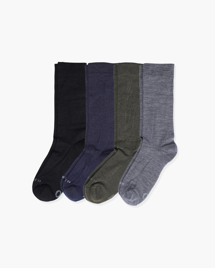 mens crew sock in a 4 pack. 1 black, 1 navy, 1 loden and 1 heather grey.
