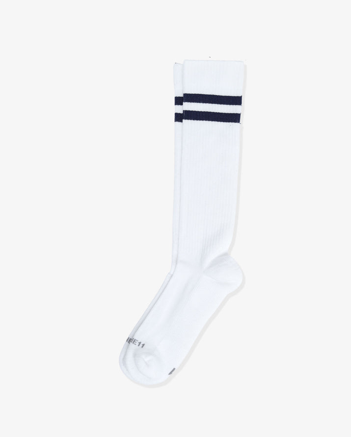 Mens over the calf sock in navy with two royal blue stripes at top, laid flat.