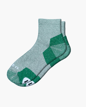 mens quarter sock in green laid flat