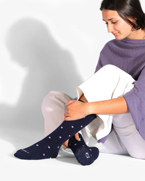 Womens navy sock with purple dots, crew height, lifestyle image.