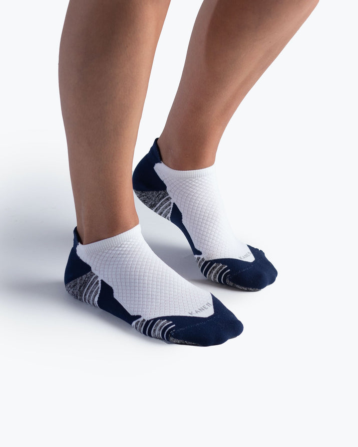 womens ankle sock in navy with white on feet