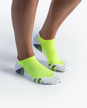 womens ankle sock in white with neon yellow on feet