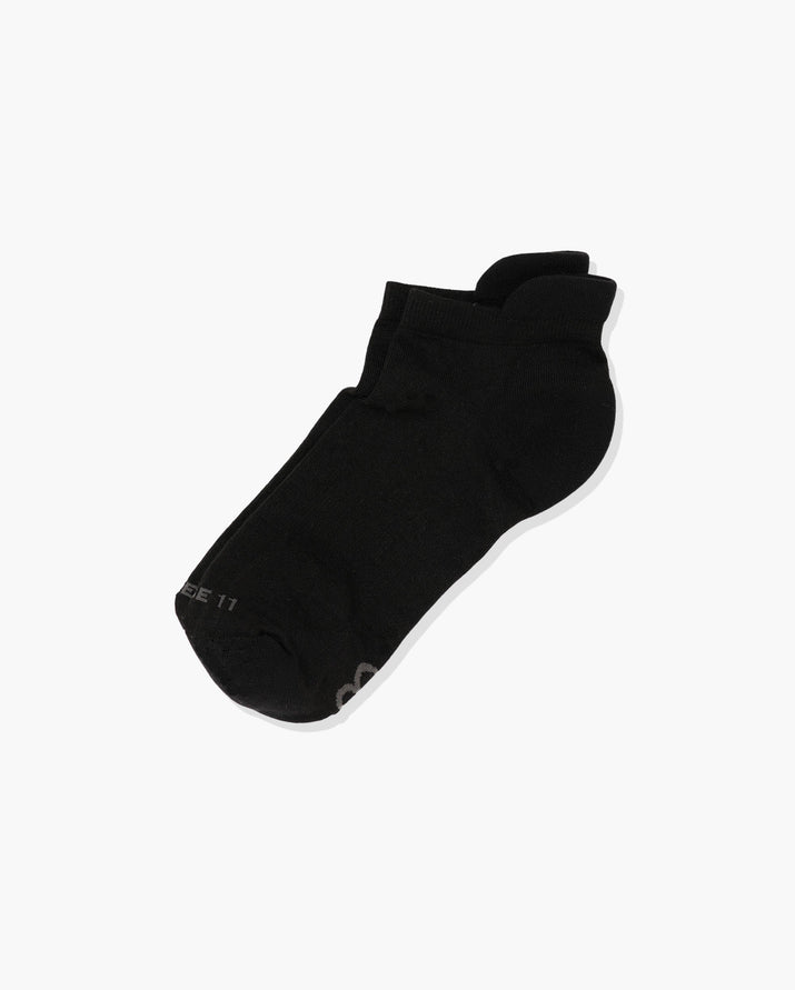 Womens ankle sock in black laid flat