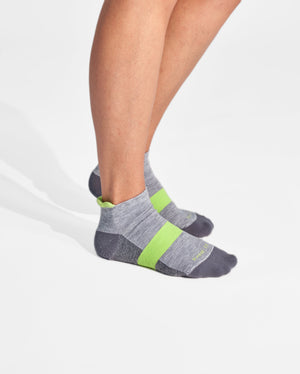 womens ankle sock in heather grey with lime on feet