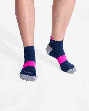 womens ankle sock in navy with neon pink on feet