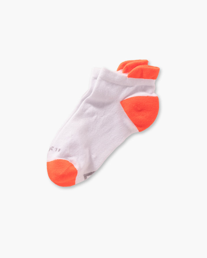 womens ankle sock in white with neon orange laid flat