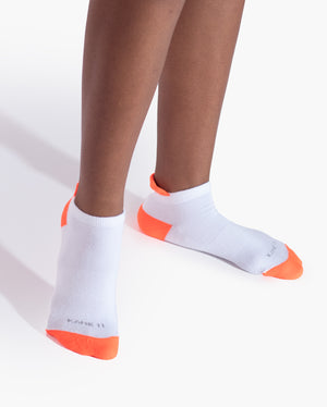 womens ankle sock in white with neon orange on feet