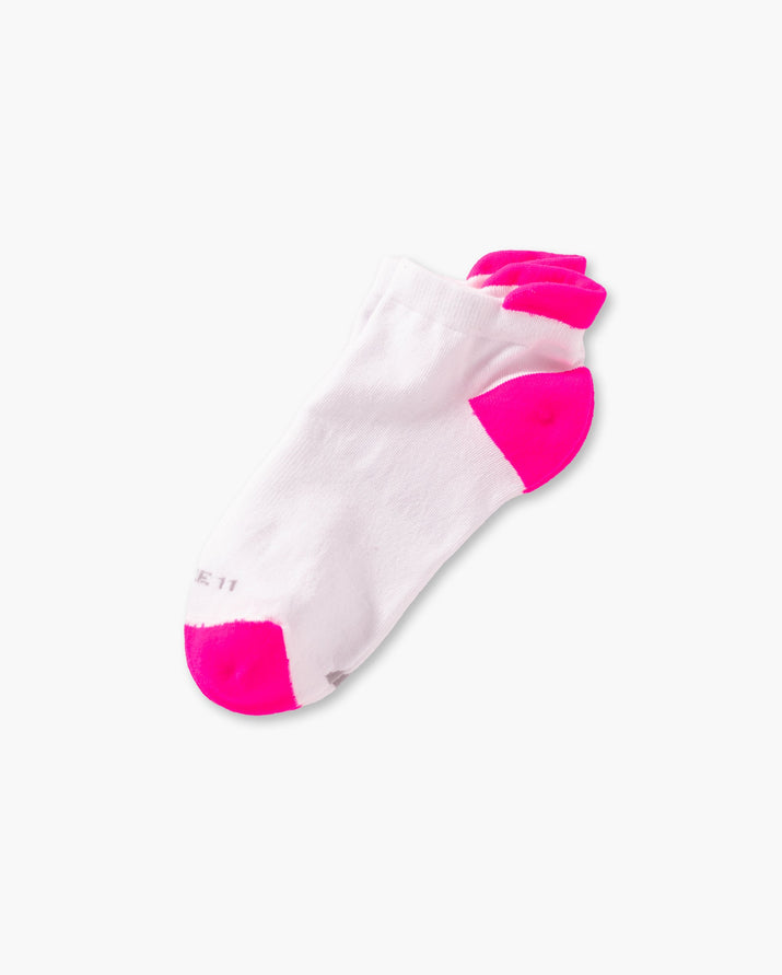 womens ankle sock in white with neon pink laid flat