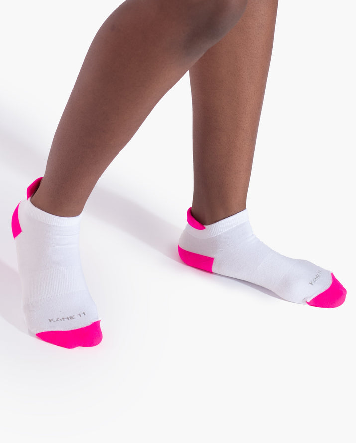 womens ankle sock in white with neon pink on feet