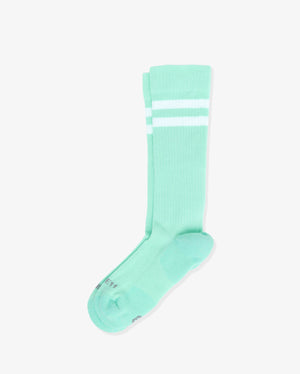 Womens crew sock in mint green with two white stripes at top, laid flat.