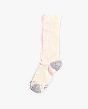 Womens crew sock in ivory with heather grey heal toe caps, laid flat.