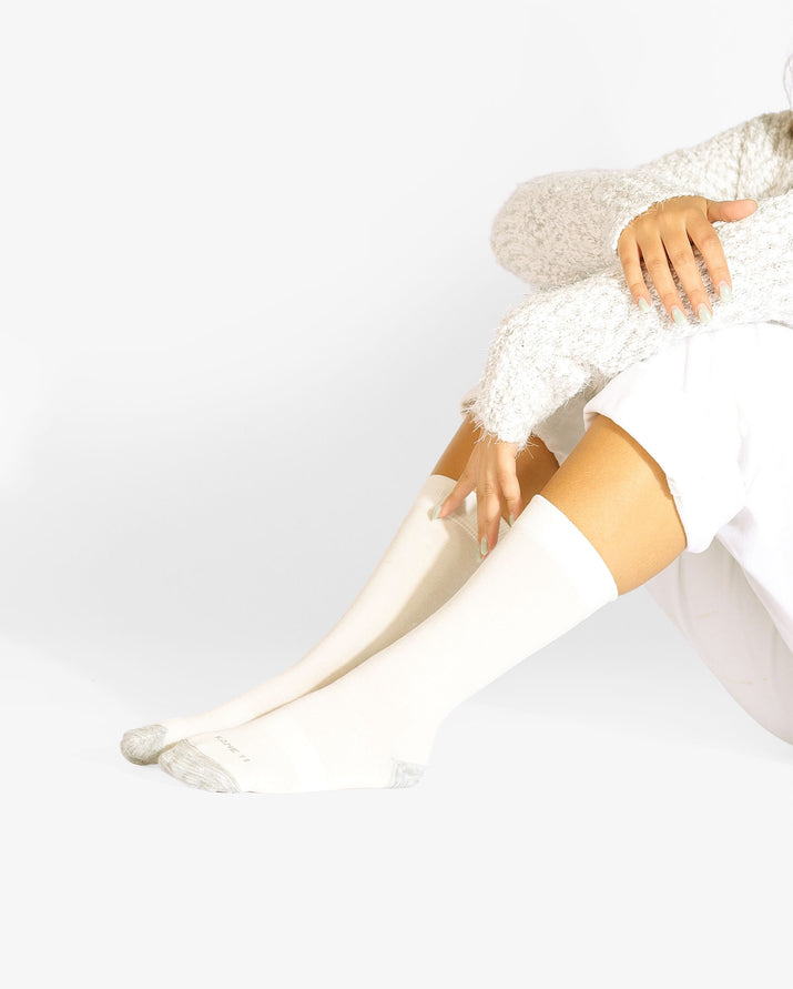 Womens crew sock in ivory with heather grey heal toe caps, lifestyle image.