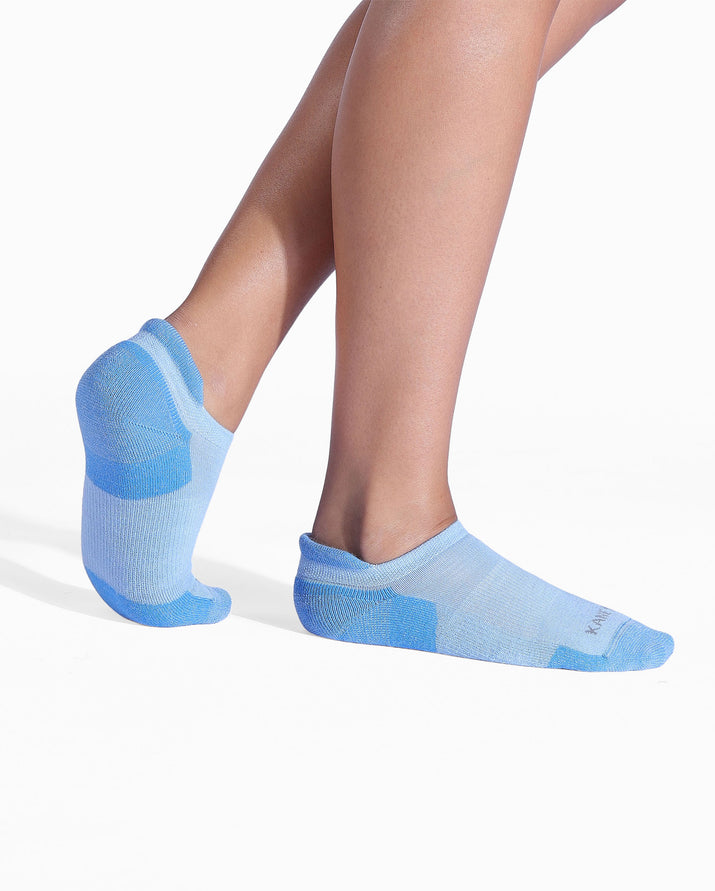 Womens baby blue sock, ankle height, on feet.