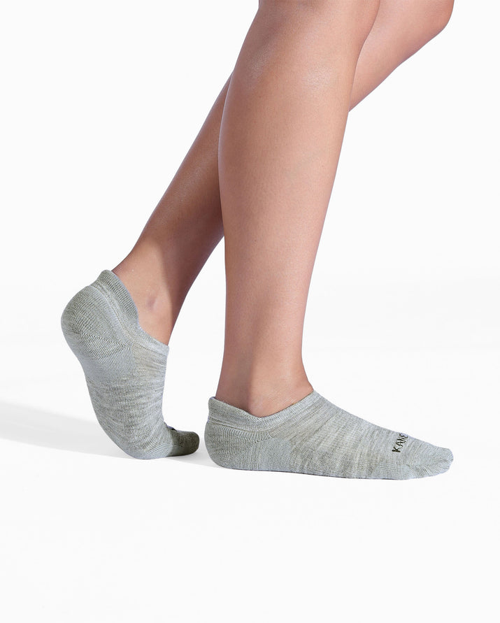 Womens heather grey sock, ankle height, on feet.