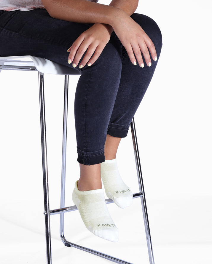Womens ivory sock, ankle height, lifestyle image.