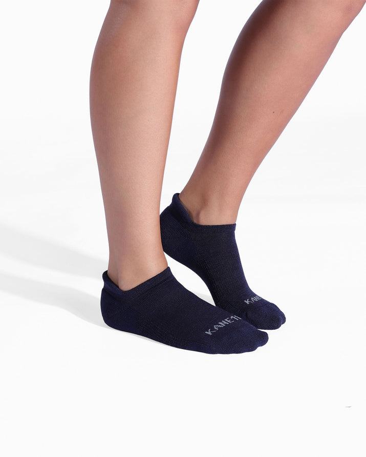 Womens navy sock, ankle height, on feet.