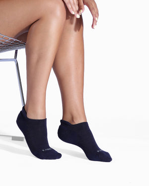 Womens navy sock, ankle height, lifestyle image.