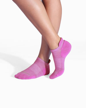 Womens violet sock, ankle height, on feet.