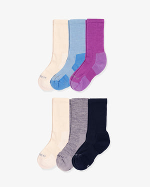 Womens 6 pack of crew socks. Two pairs of Ivory and one pair of each colorway: baby blue, violet, heather grey, navy.