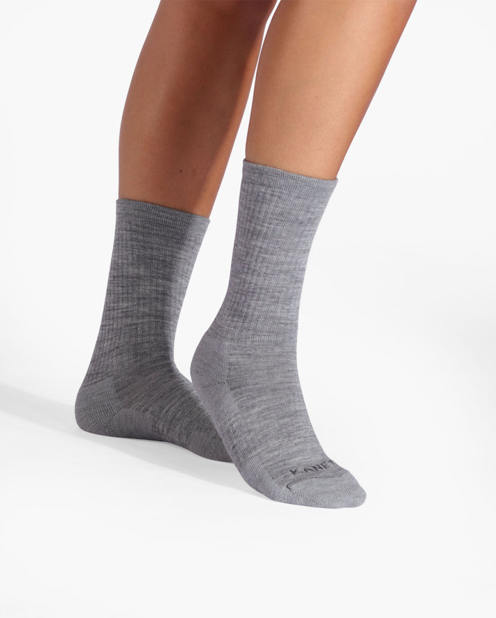 womens heather grey sock, crew height, on feet.