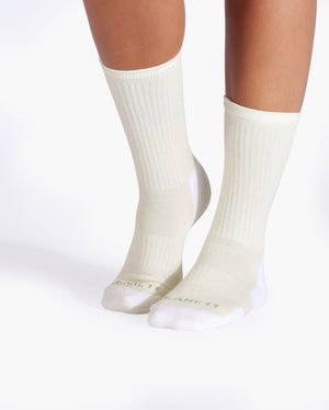 womens ivory sock, crew height, on feet.
