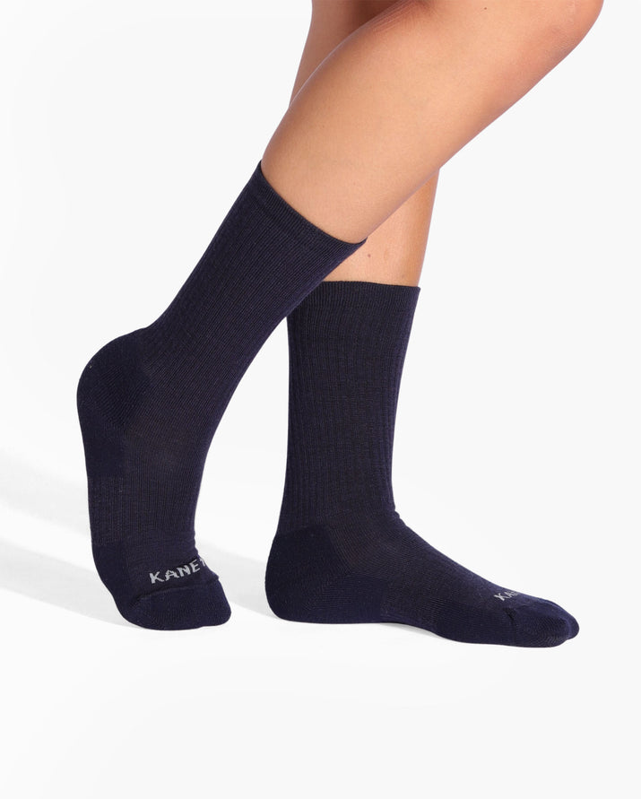 womens navy sock, crew height, on feet.