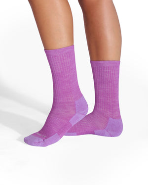 womens violet sock, crew height, on feet.