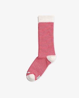 Womens crew sock in red with white stripes. White toe, heel caps and cuff. laid flat.