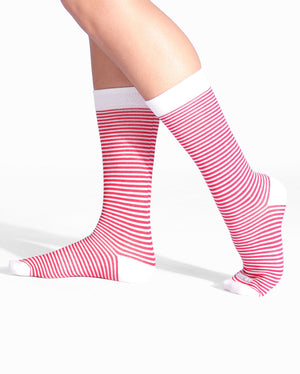Womens crew sock in red with white stripes. White toe, heel caps and cuff. on feet.