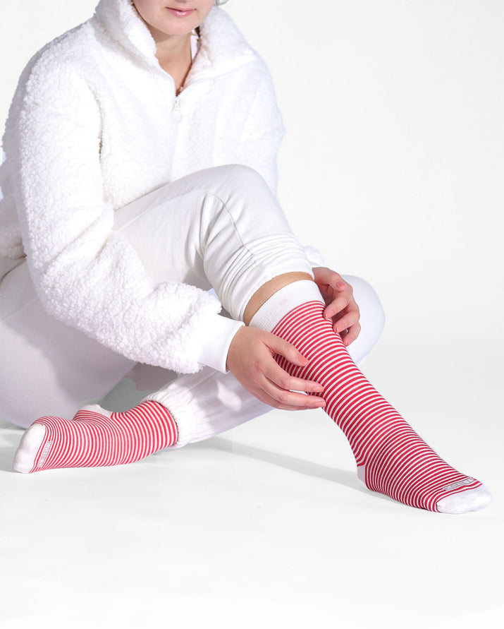 Womens crew sock in red with white stripes. White toe, heel caps and cuff. lifestyle.