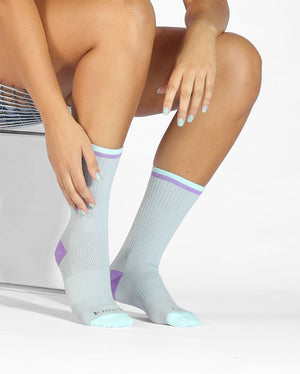 Womens grey sock, crew height, lifestyle image.