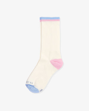 Womens crew sock in ivory, laid flat. blue toe cap and pink heel cap. One blue and one pink stripe at top of crew.
