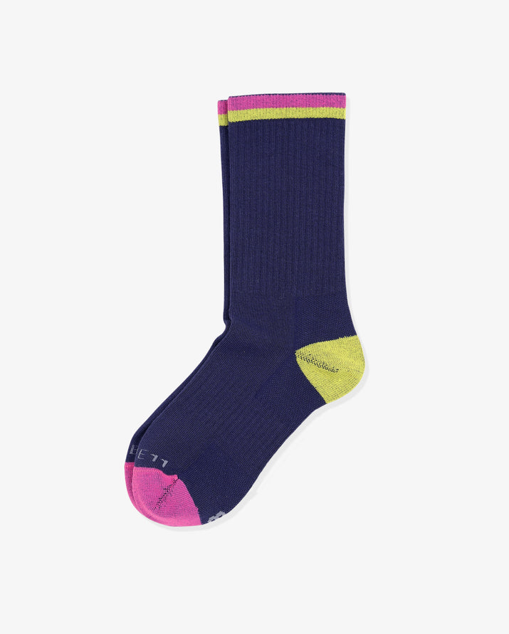 Womens crew sock in navy, laid flat. pink toe cap and yellow heel cap. One pink and one yellow stripe at top of crew.
