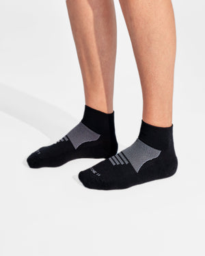 womens quarter sock in black with grey on feet