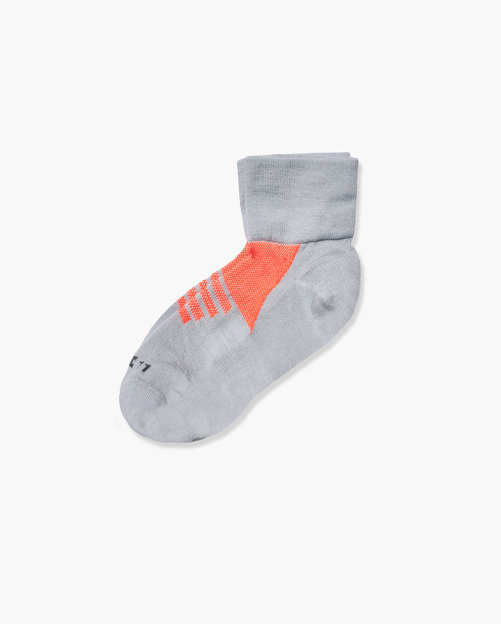 womens quarter sock in grey with neon orange laid flat