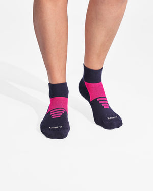 womens quarter sock in navy with neon pink on feet