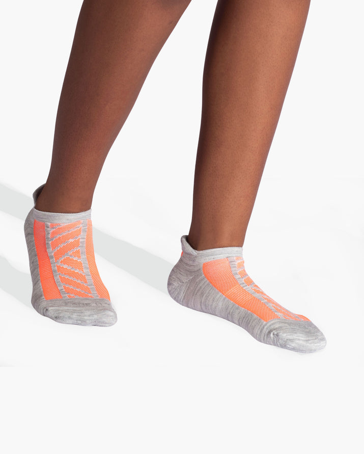 womens ankle sock in grey with neon orange on feet
