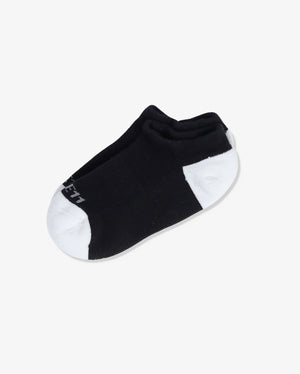 Womens ankle sock in black with ivory heel and toe caps, laid flat.