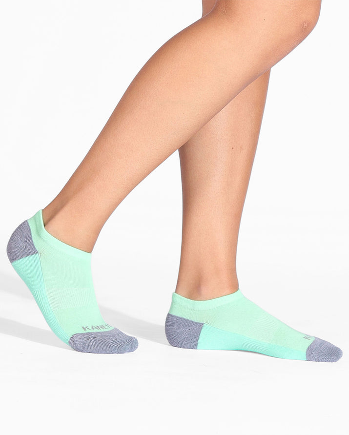 Womens ankle sock in mint green with grey heel and toe caps, on feet.