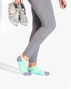Womens ankle sock in mint green with grey heel and toe caps, lifestyle image.