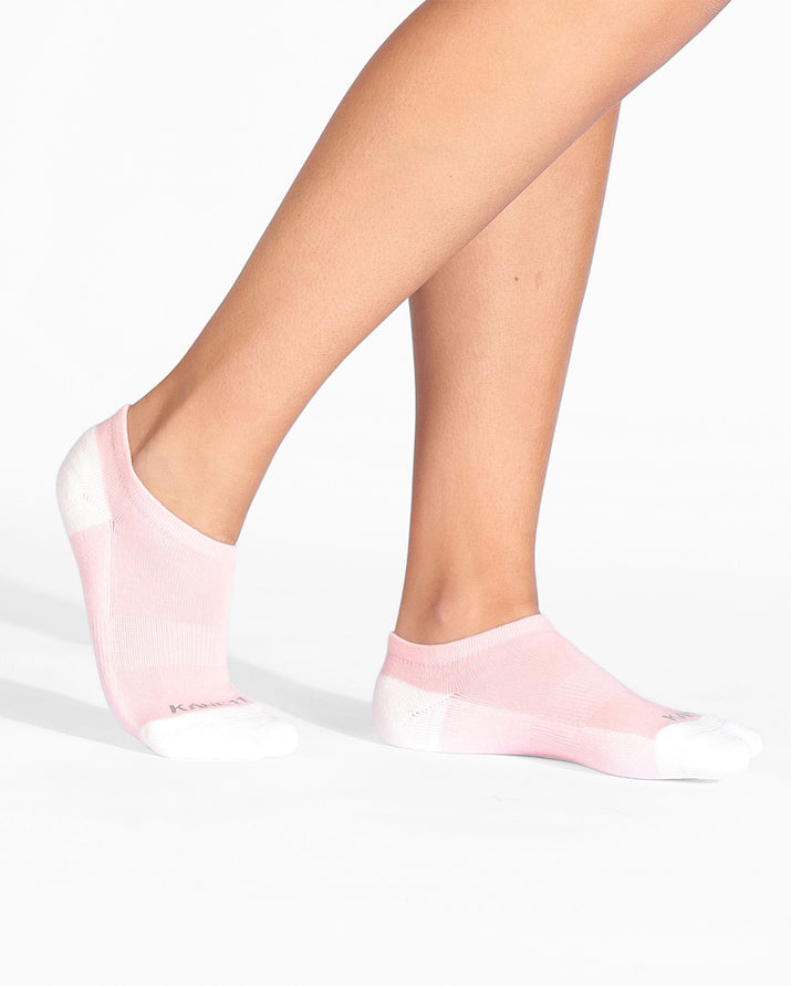 Womens ankle sock in pink with ivory heel and toe caps, on feet.