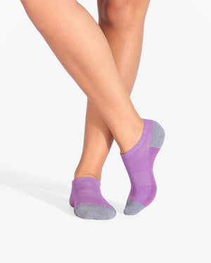 Womens ankle sock in purple with grey heel and toe caps, on feet.