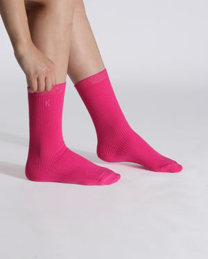 womens hot pink sock, crew height, on feet.