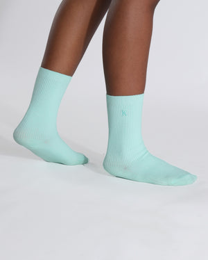 womens mint sock, crew height, on feet.