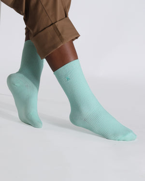 womens mint sock, crew height, lifestyle image.