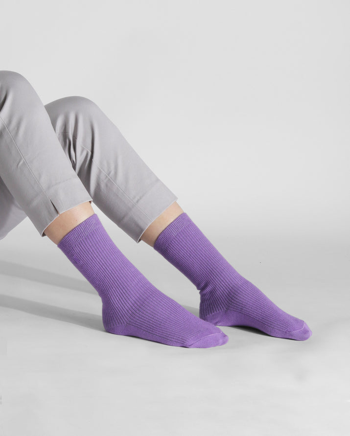 womens violet sock, crew height, lifestyle image.