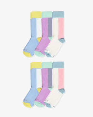 Womens 6 pack of crew socks. Two pairs of each: blue with yellow and ivory, purple with green and grey, ivory with blue and pink.