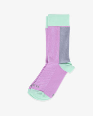 Womens crew sock in purple with mint green heel and toe caps. Mint green cuff and grey between the top cuff and the heel. Laid flat.
